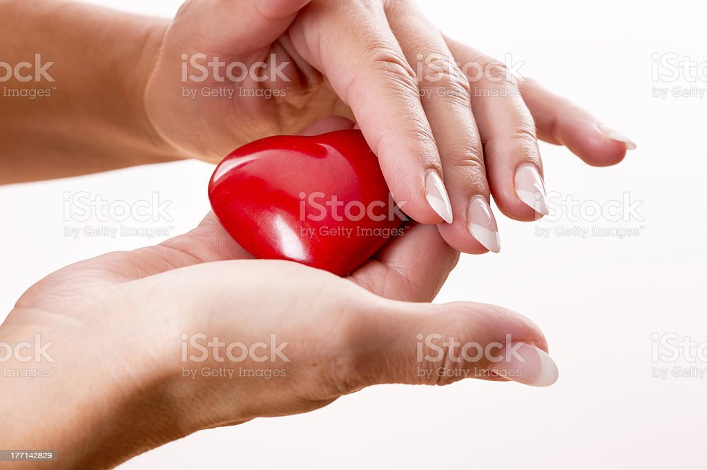 Red heart in woman hands on white royalty-free stock photo