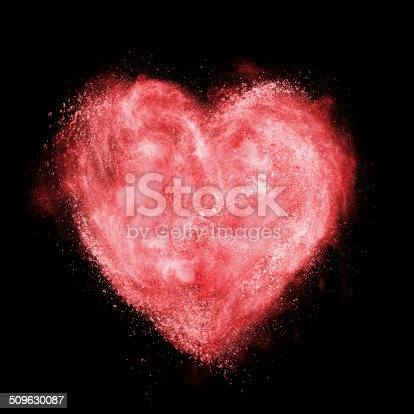 497300769 istock photo red heart made of powder explosion isolated on black 509630087