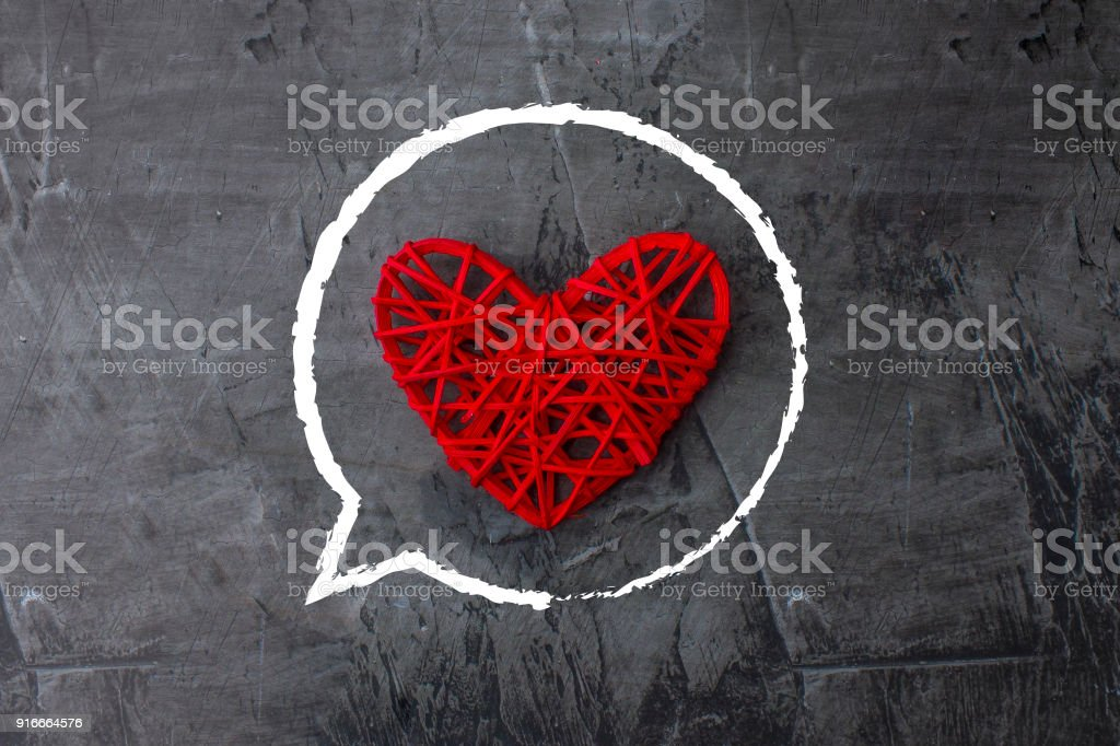 Red heart on a dark background. Love theme, wedding, St. Valentine's Day stock photo