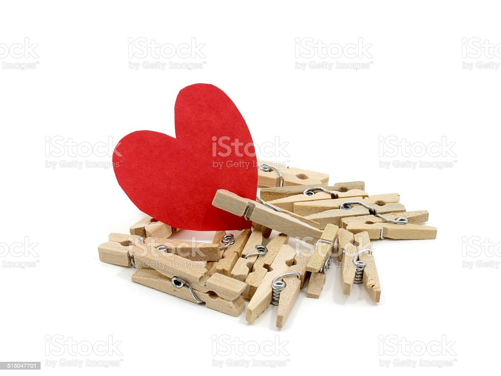 Red heart on many wooden pins stock photo