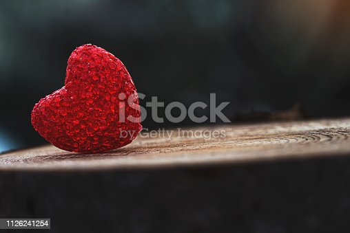 istock Red heart on wood background in nature 1126241254
