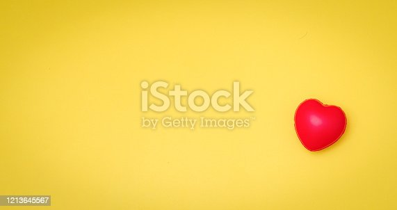 istock Red Heart on yellow paper card table top view background concept for Valentine day banner, mother day gift banner, happy birthday backdrop, greeting mom sweet care board, wedding romantic texture. 1213645567