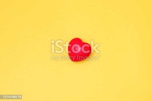 istock Red Heart on yellow paper card table top view background concept for Valentine day banner, mother day gift banner, happy birthday backdrop, greeting mom sweet care board, wedding romantic texture. 1214149173