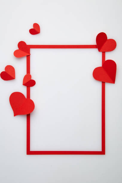 Cтоковое фото Red heart paper love of red frame on white background