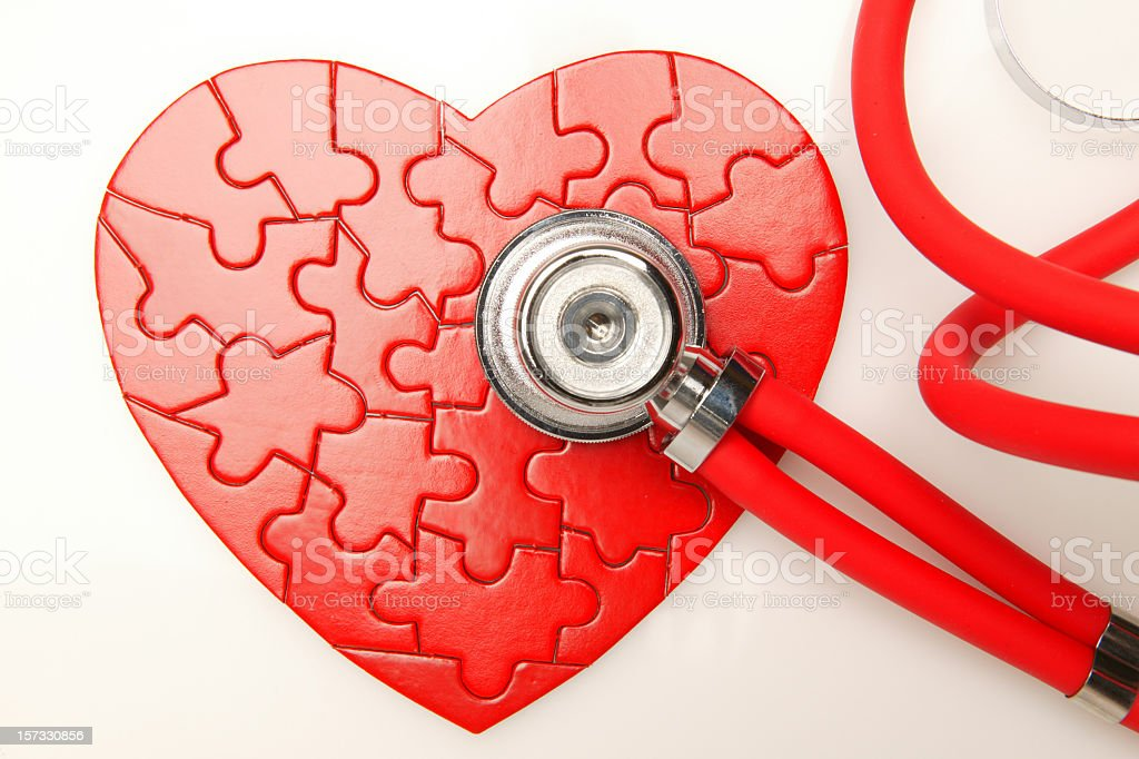 Red heart Puzzle with stethoscope royalty-free stock photo