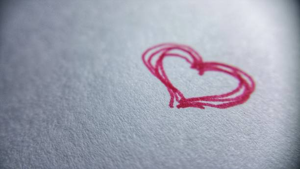 red heart scribble doodle white paper stock photo