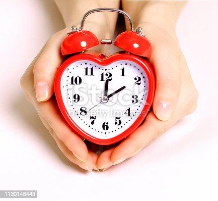 816405814 istock photo Red heart shape alarm clock 1130148443