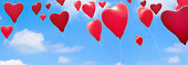 red heart shape balloons in the air panorama