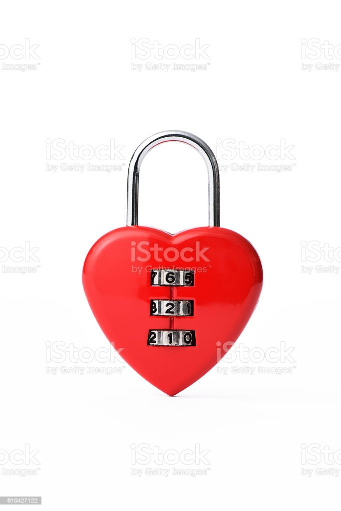 Red heart shape combination lock on white background stock photo