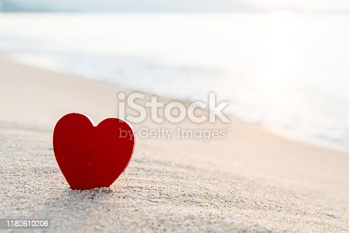 Red heart shape on the beach