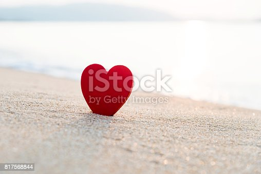 istock Red heart shape on the beach 817568844