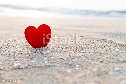 istock Red heart shape on the beach 817571122