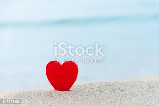 istock Red heart shape on the beach 817578190
