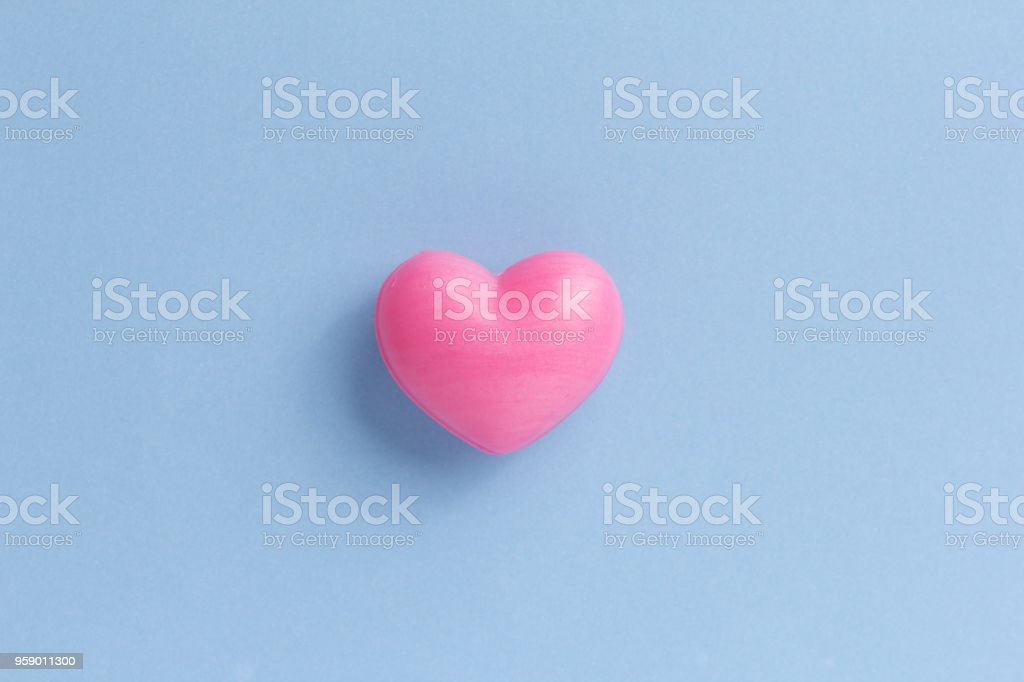 Red heart shape over blue table. Romantic Valentine Day concept with copy space stock photo