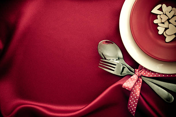 red heart shape with White plate with fork and spoon – Foto