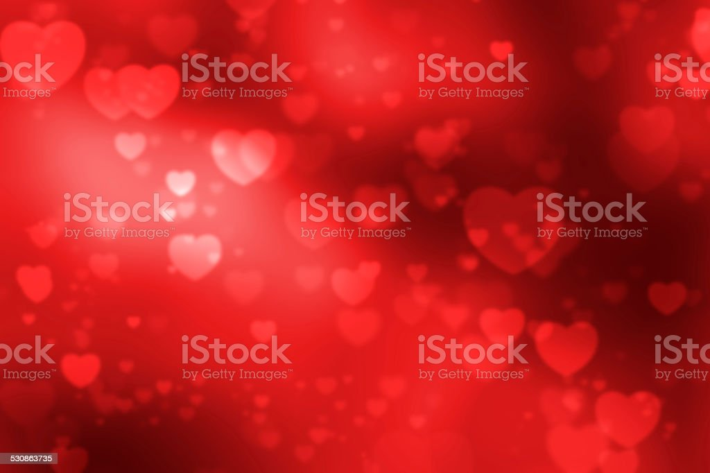Red heart shaped bokeh background stock photo