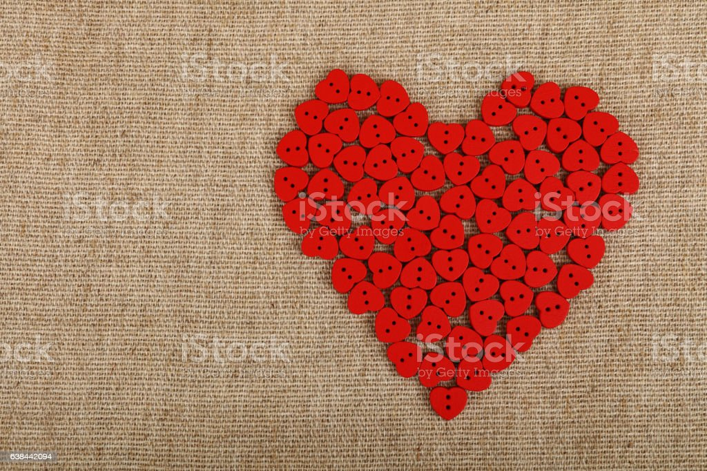 Red Heart Shaped Sewing Buttons On Canvas Stock Photo