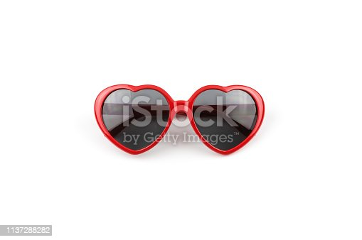 Red heart shaped sunglasses isolated on white background, summer holidays, valentines day, travel.