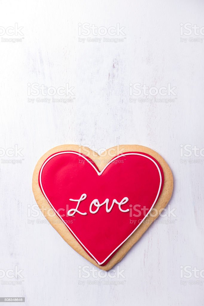 red, heart shaped Valentine cookie stock photo