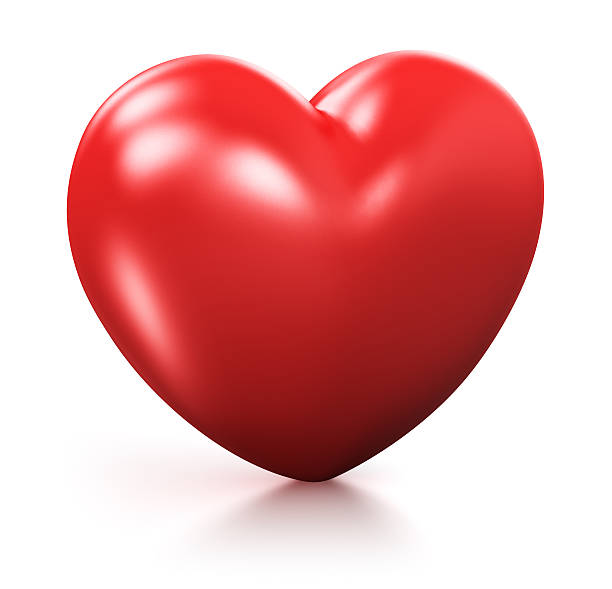 3D red heart standing against white background stock photo