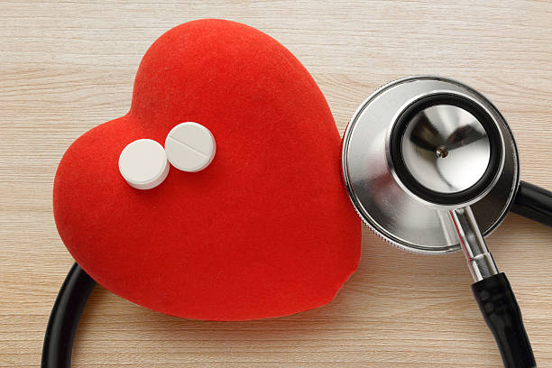 Red heart, stethoscope and pills stock photo