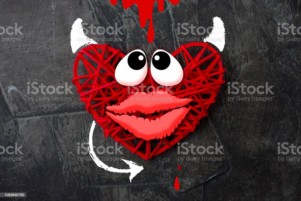 Red heart with a horn and tail of the devil Theme for Valentines Day stock photo