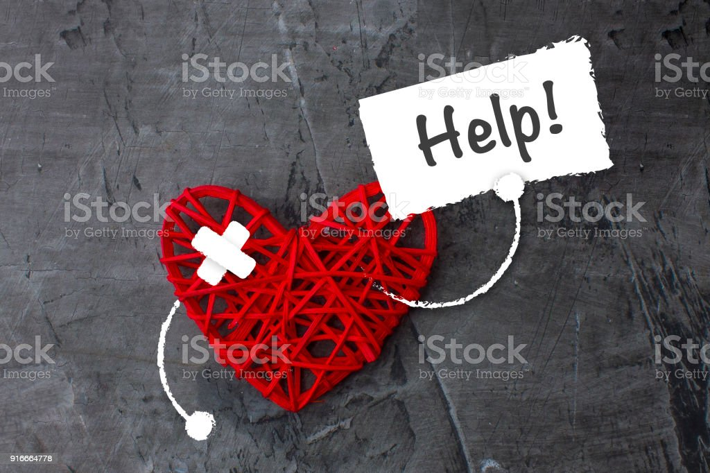 Red heart with a sign asking for help. Theme of medicine, health. Copy space stock photo