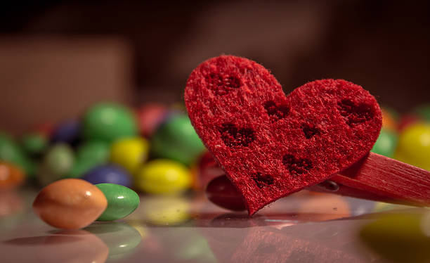 red heart with colored candies stock photo