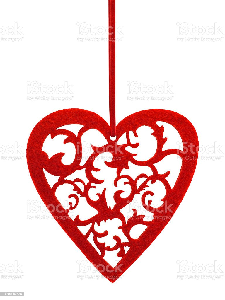 Red heart with floral ornament hanging on a ribbon royalty-free stock photo
