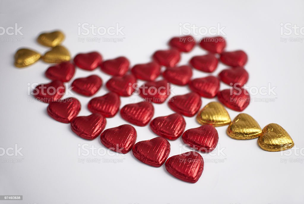 Red heart with golden arrow royalty-free stock photo