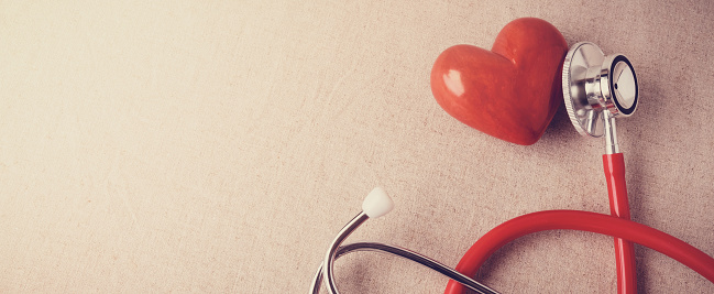 istock red heart with stethoscope, heart health,  health insurance concept 1163452227