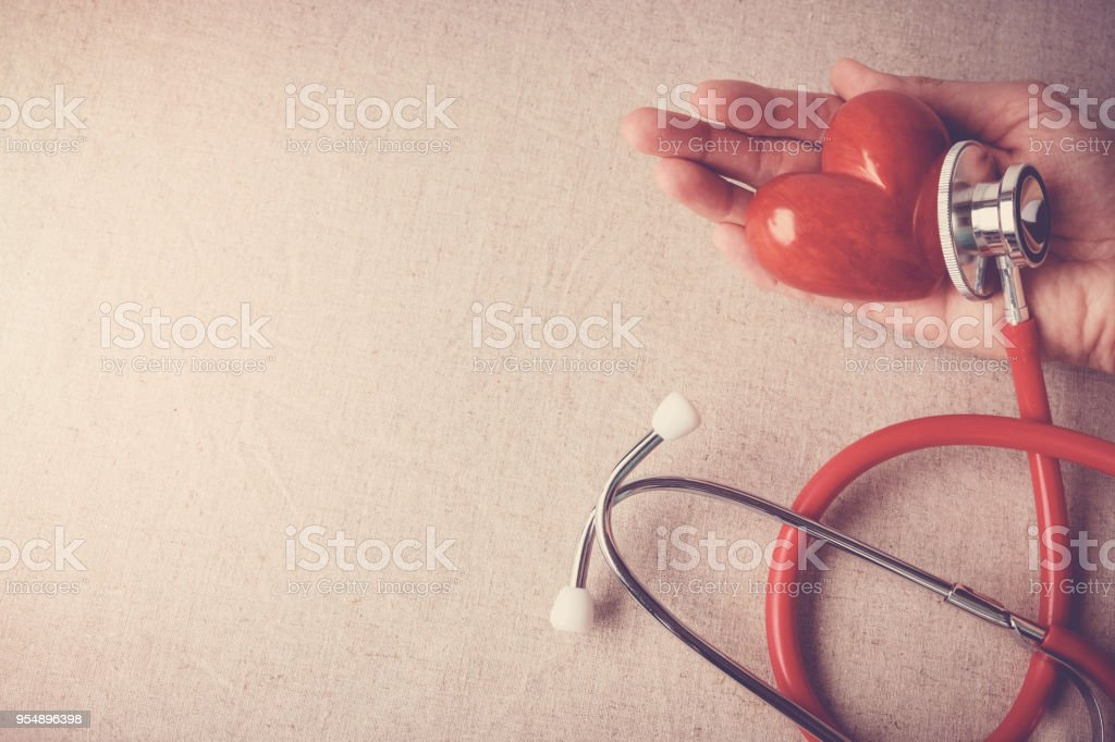 red heart with stethoscope, heart health,  health insurance concept stock photo