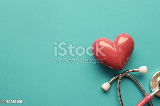istock Red heart with stethoscope on blue background, heart health,  health insurance concept, World heart day, world health day 1182565406