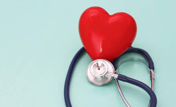 Red heart with stethoscope on blue wooden background. Copy space. Valentines day. – zdjęcie