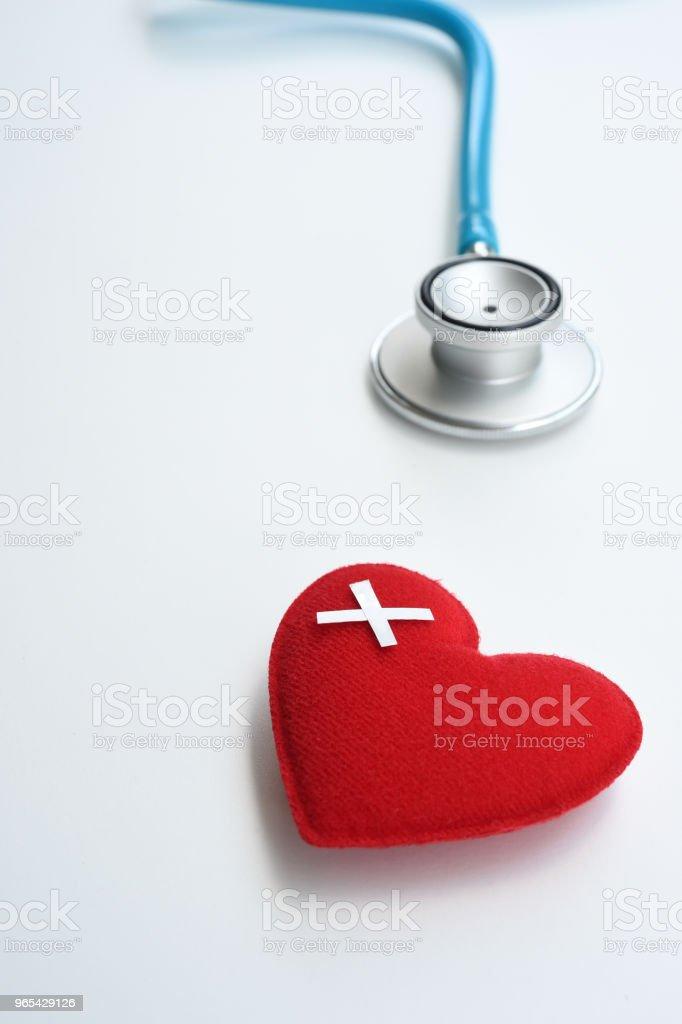 Red heart with stethoscope zbiór zdjęć royalty-free
