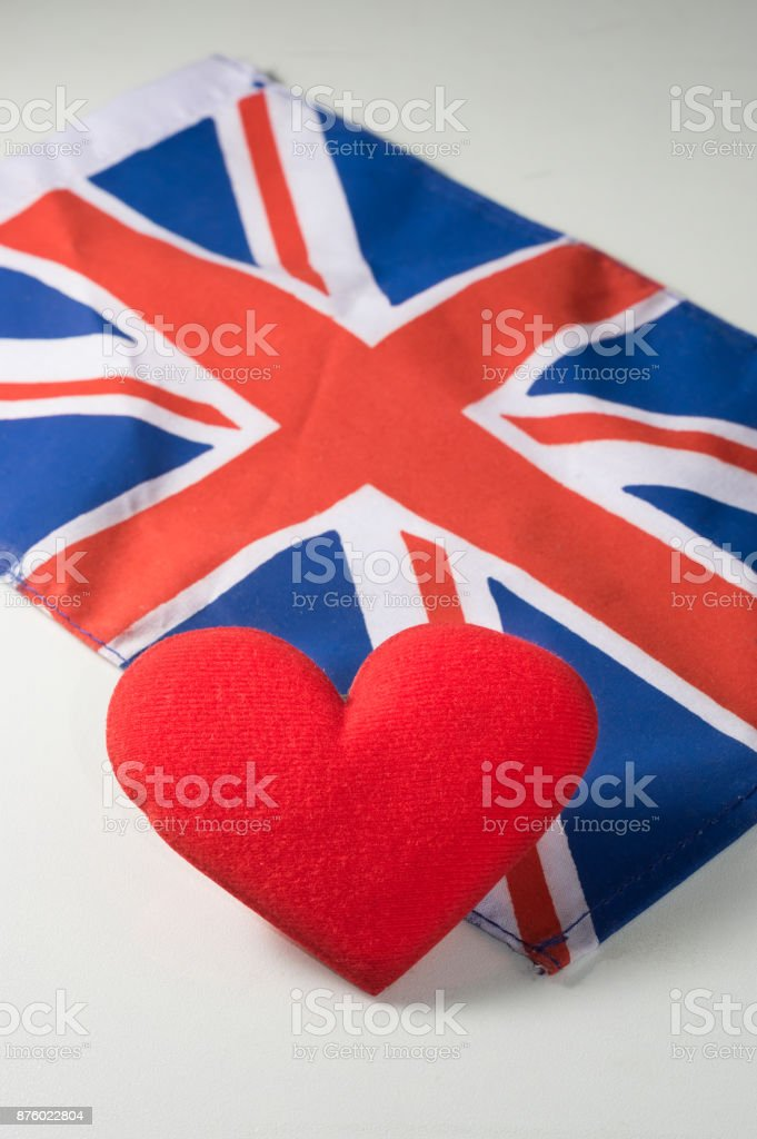 Red heart with United Kingdom national flag. stock photo