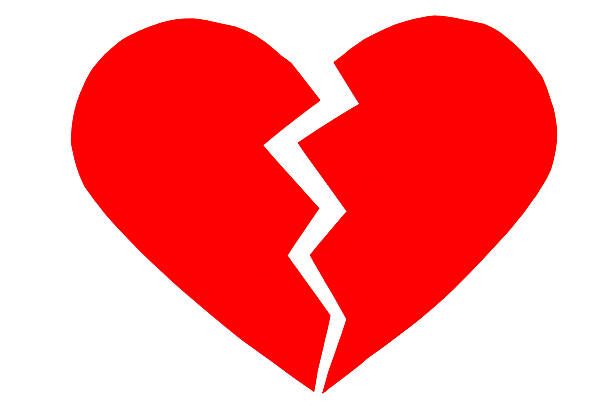 Red heartbreak / broken heart. close up of a paper bildbanksfoto