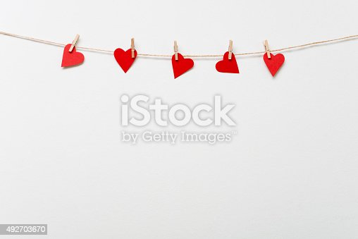 istock Red hearts hanging on clothesline 492703670