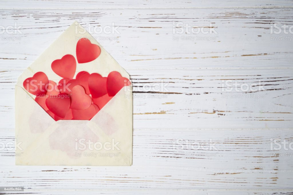 Red hearts in an envelope stock photo