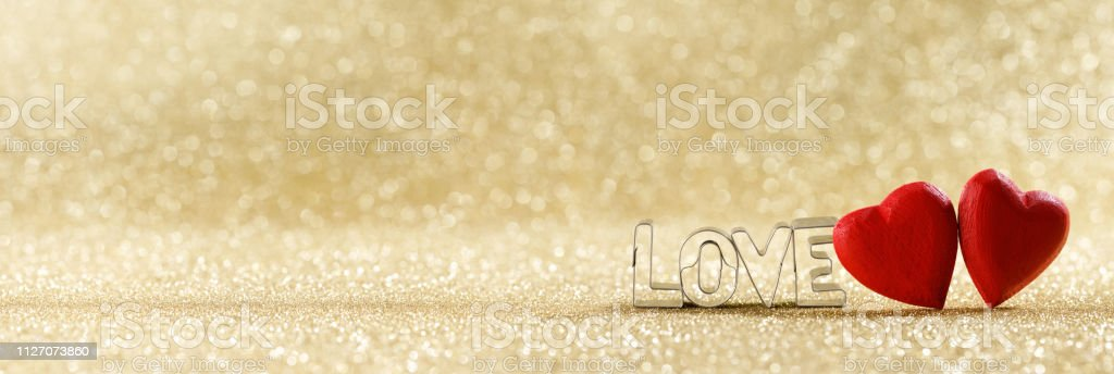 Red hearts on glitter background stock photo