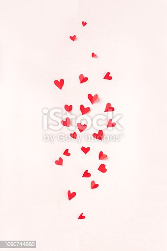 Red hearts on pink pastel background. Romantic love concept, Valentine day or wedding theme, copy space.