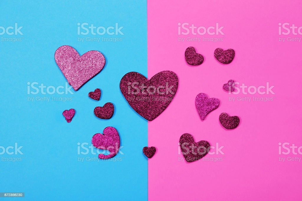 Red hearts on two tone background, Valentines day background stock photo