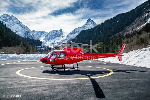 istock Red Helicopter in the mountains 1211368489