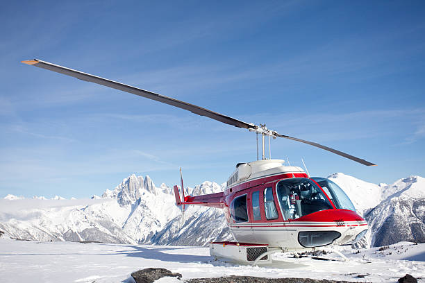 Red Helicopter on a Mountain in Winter stock photo