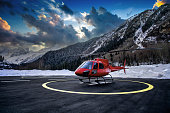 istock Red helicopter on the helipad at sunset. 1225544726