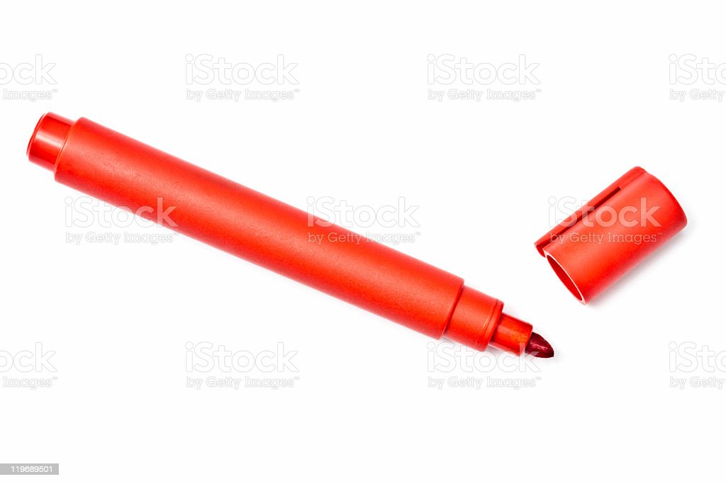 A red highlighter lying on a white background with open cap  stock photo