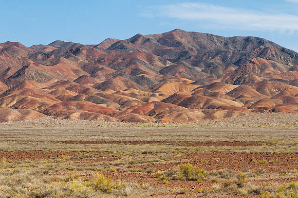 Red hills in Kazakhstan Red geological formations in the steppes of Kazakhstan. steppe stock pictures, royalty-free photos & images
