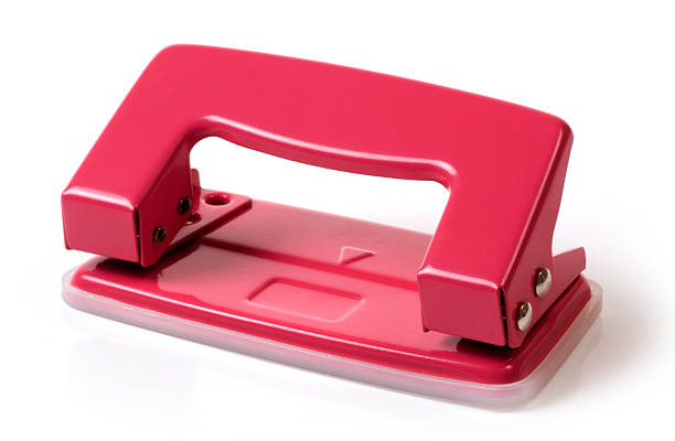 Red hole puncher stock photo