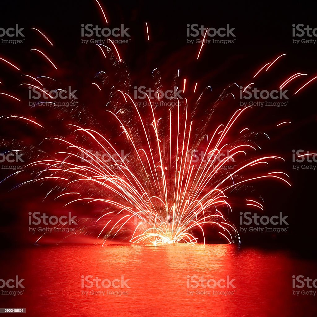 Red holiday fireworks on the lake royalty-free stock photo