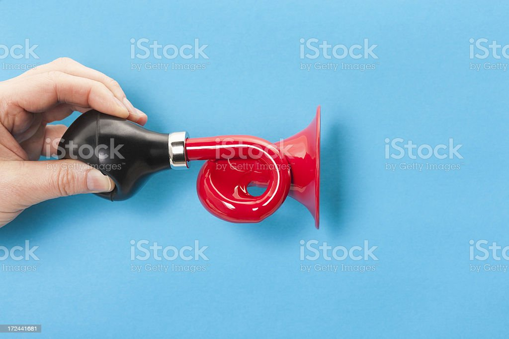 Red horn or trumpet on blue background stock photo